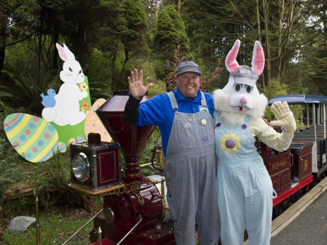 VANCOUVER: March 26 ,2015. - Engineer Tony Hamaliuk hangs out with the Easter Bunny after at the Easter Train. Operated by the Vancouver Park Board, the Easter Train takes off in Stanley Park March 28 and 28 and April 1 to 6. The popular ride includes an Easter egg huntoutdoors on sunny days and indoors if its raininggames, crafts, face painting, and of course the Easter bunny and chick. VANCOUVER, March 26, 2015. (Jenelle Schneider/PNG staff photo) (for PRVstory by ).